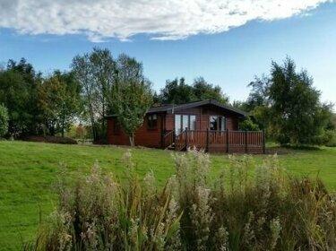 The Log Cabin Glebe Farm