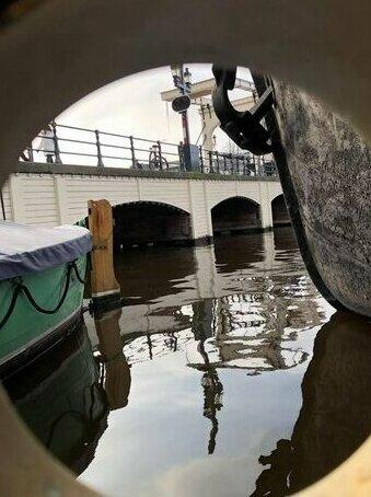 Skinny bridge boat