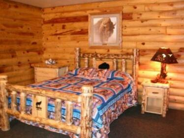 Wolf Den Log Cabins and RV Park